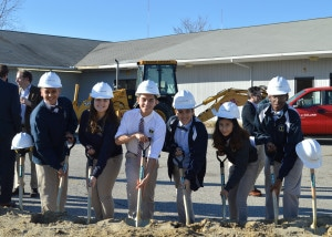 High School scholars holding shovels and breaking ground on the new BVP High School