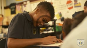 A BVP middle school scholar working on an assignment. Image links to a video.