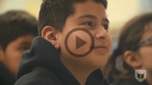 A close-up photo of a BVP scholar. Image links to a video.