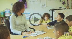 A BVP teacher working with a group of elementary school scholars. Image links to a video.