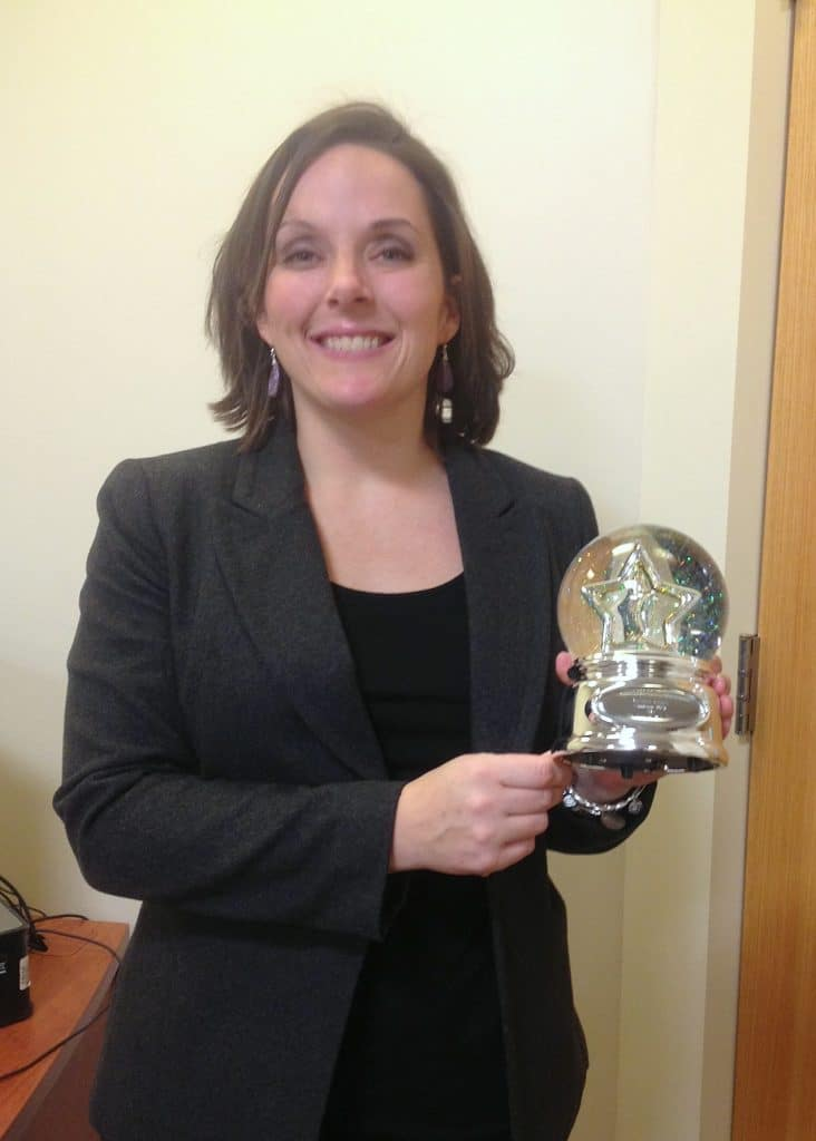 Dr. Michaela Keegan holding an award trophy
