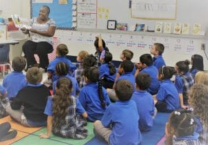 Board Member Elaine Dickson reads to a class of students