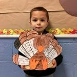 BVP scholar holding a Thanksgiving-themed art project