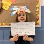 BVP scholar holding a sign about what she's thankful for