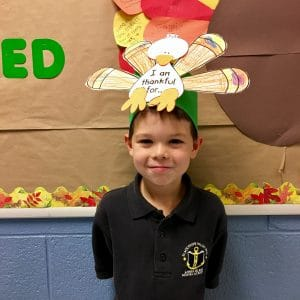 BVP scholar posing with Thanksgiving-themed art project