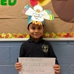 BVP scholar holding a sign about what he's thankful for