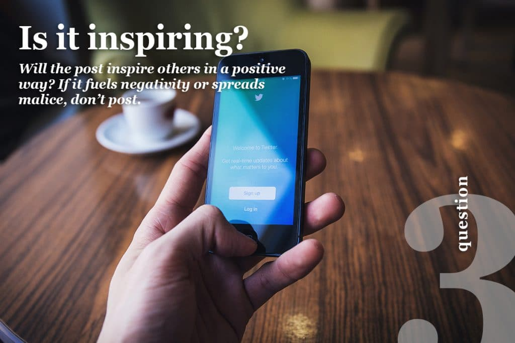 "A hand holding a cell phone with the words ""Is it inspiring?"""