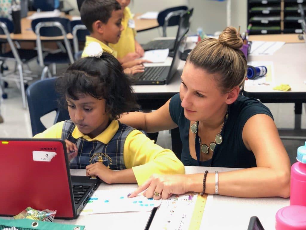 Teacher Allie Perras working with a scholar