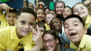 Teacher taking a selfie with a group of students