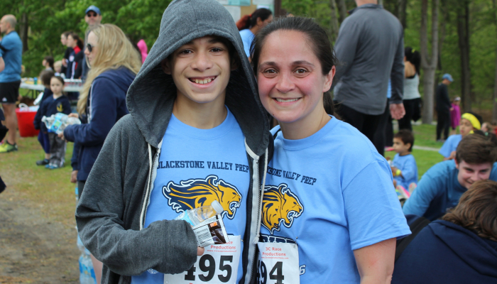 Mother and son posing for a photo following the 5K race